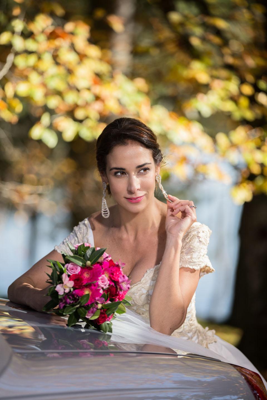 beautiful bride playfully touches her earrings at McLaren Falls Park in Tauranga