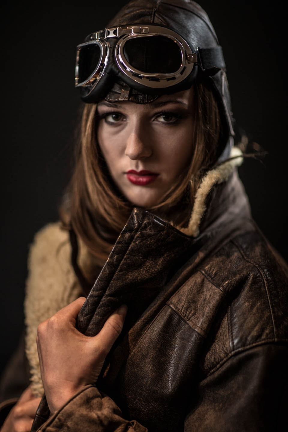 young women in a flying helmet and jacket