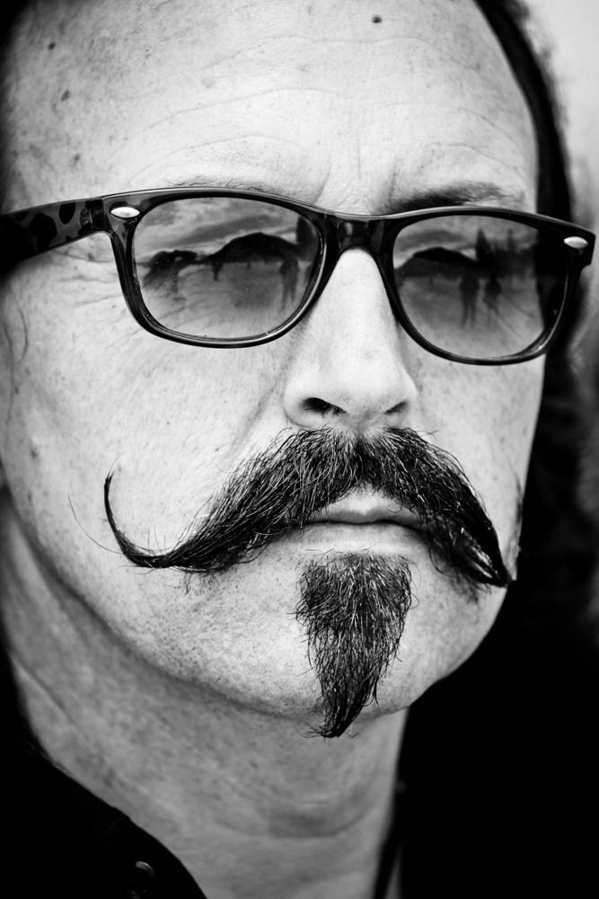 black and white image of a man with a handlebar moustache