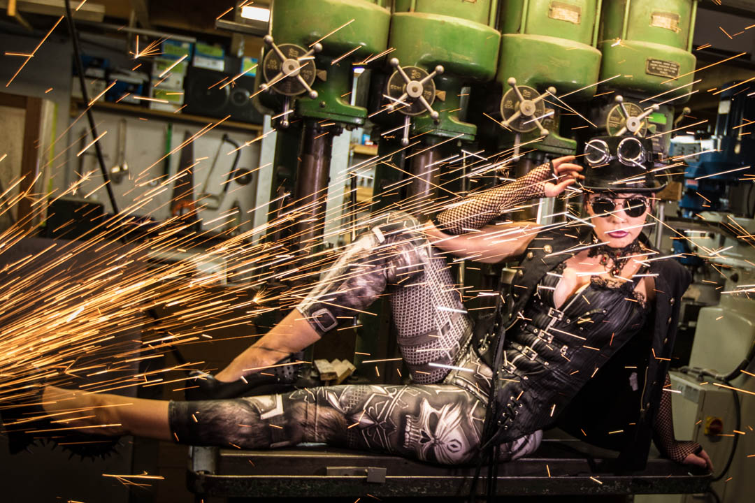 Steampunk women in colour with grinder sparks