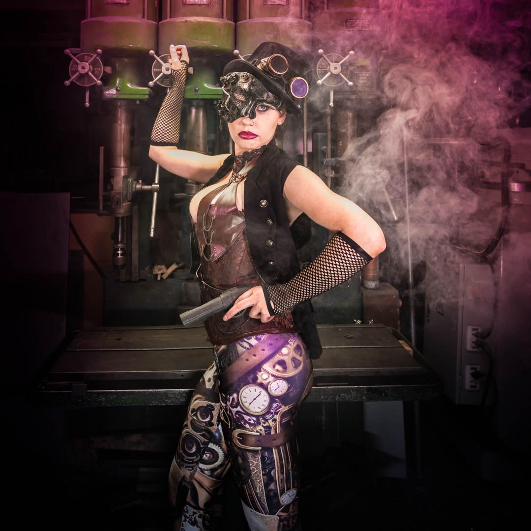 Steampunk women in purple smoke