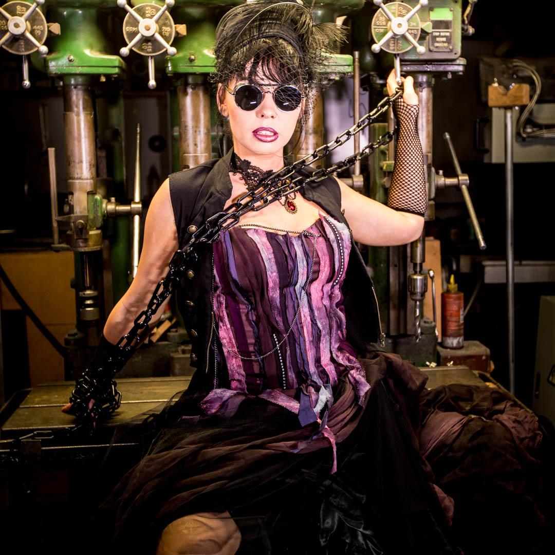 Steampunk women with purple vintage dress