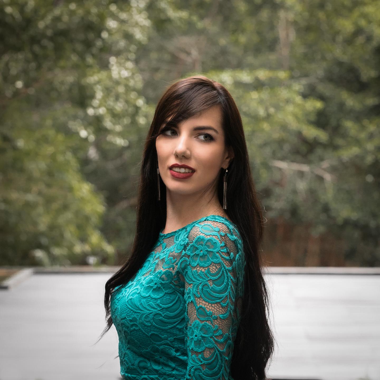 Alina is a beautiful Russian model in green dress