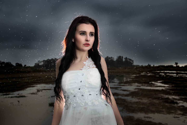 beautiful girl as it just starts to rain