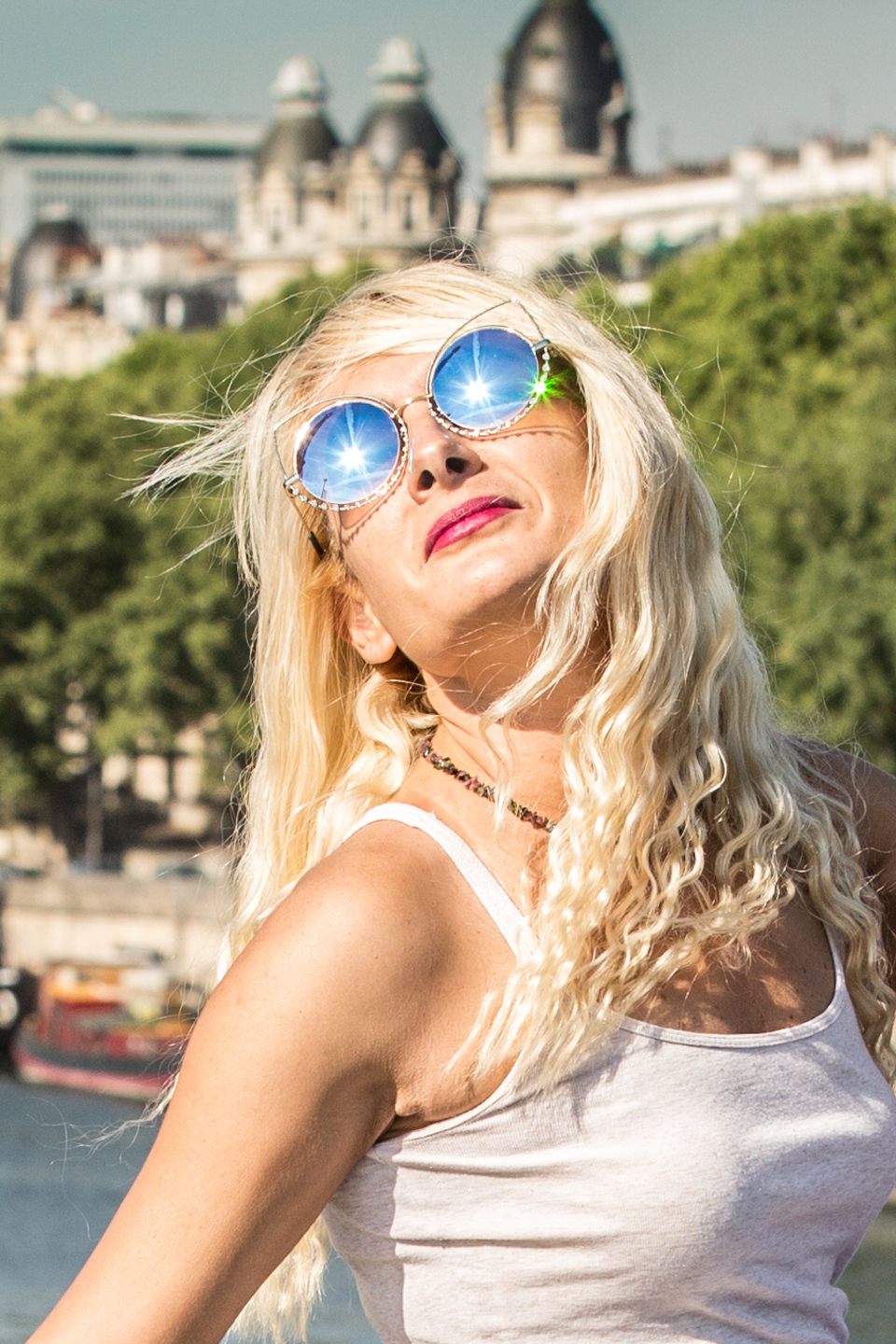 blonde model in Paris with blue sunglasses on