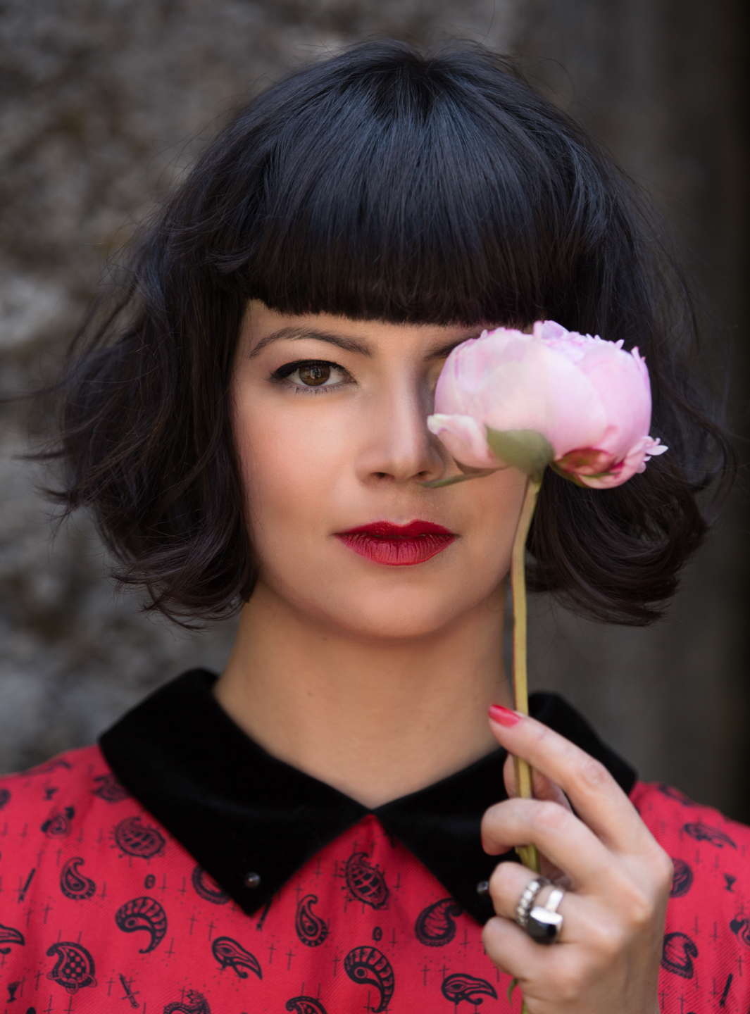 women with a flower covering her left eye