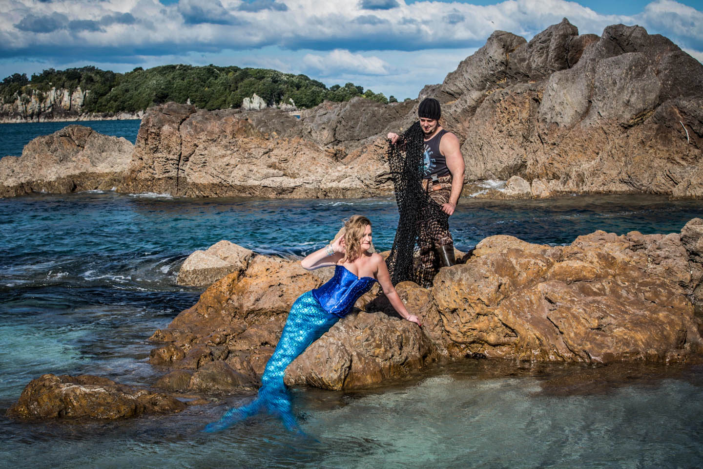 catching a mermaid on the rocks at Mount Maunganui