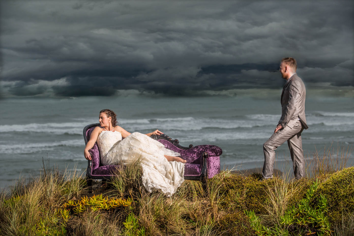 bride on a purple French chaise lounge and a approaching storm