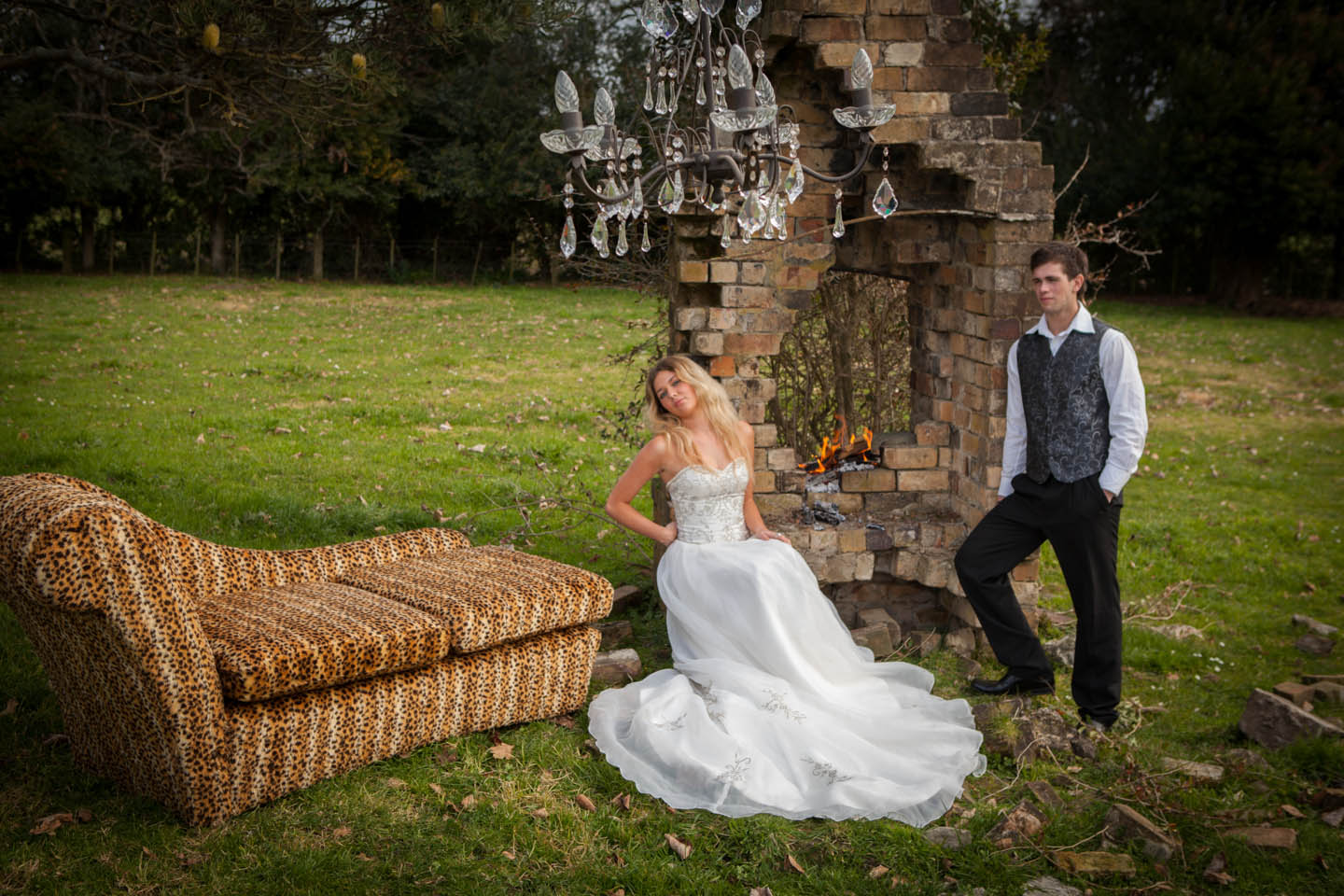 bride and groom with a leopard print covered chaise lounge