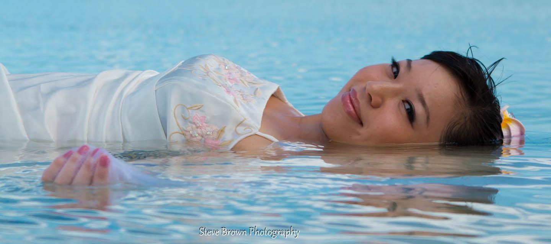 a beautiful Japanese bride floating in a tropical lagoon in Rarotonga