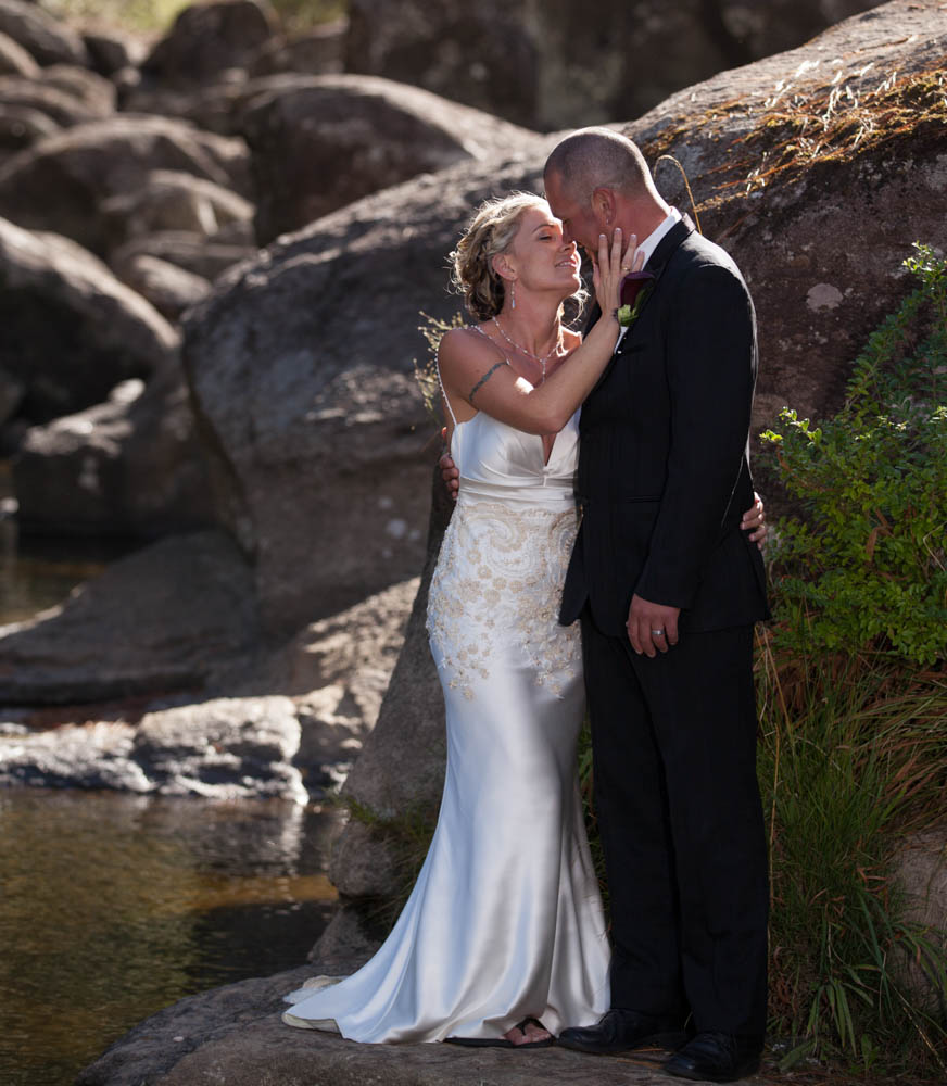 a tender touch from bride to groom at McLaren Falls Tauranga