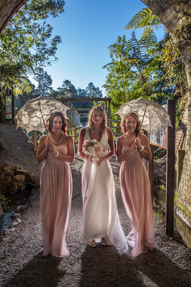 bride and her bridesmaids rim lighted in the Waihi Tunnel