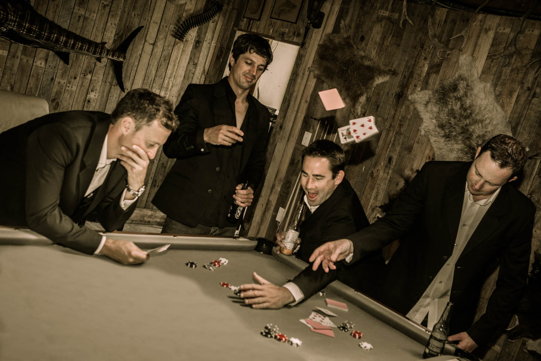 groomsmen playing cards