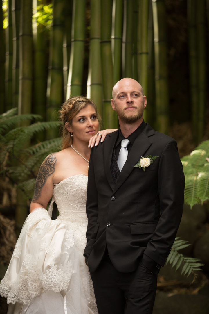 bride and groom amongst the green bush at Fountain Gardens Venue in Tauranga