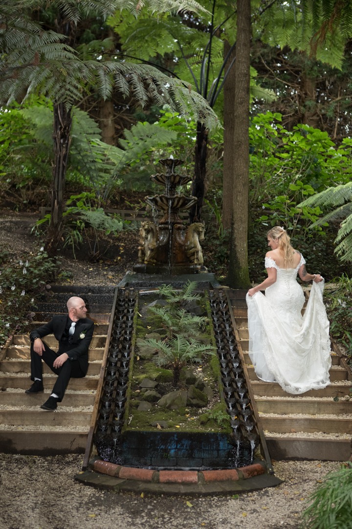 bride and groom on the waterfall staircase at Fountain Gardens Venue in Tauranga