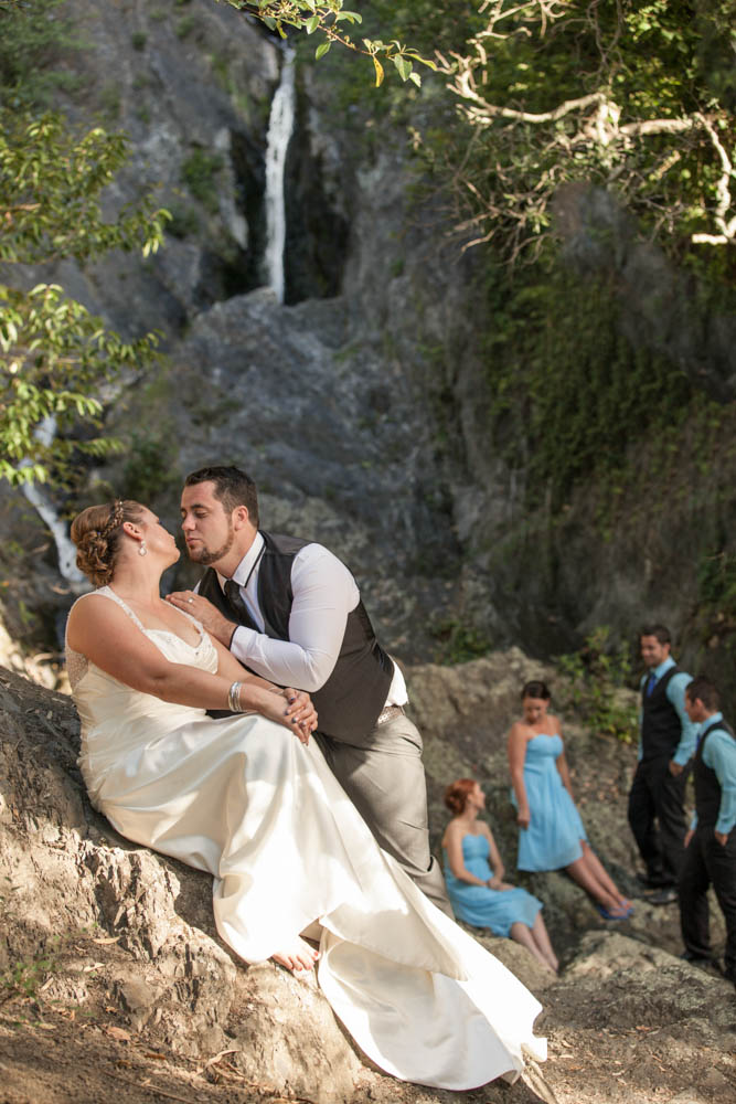 bride and groom at the waterfall in Whakatane