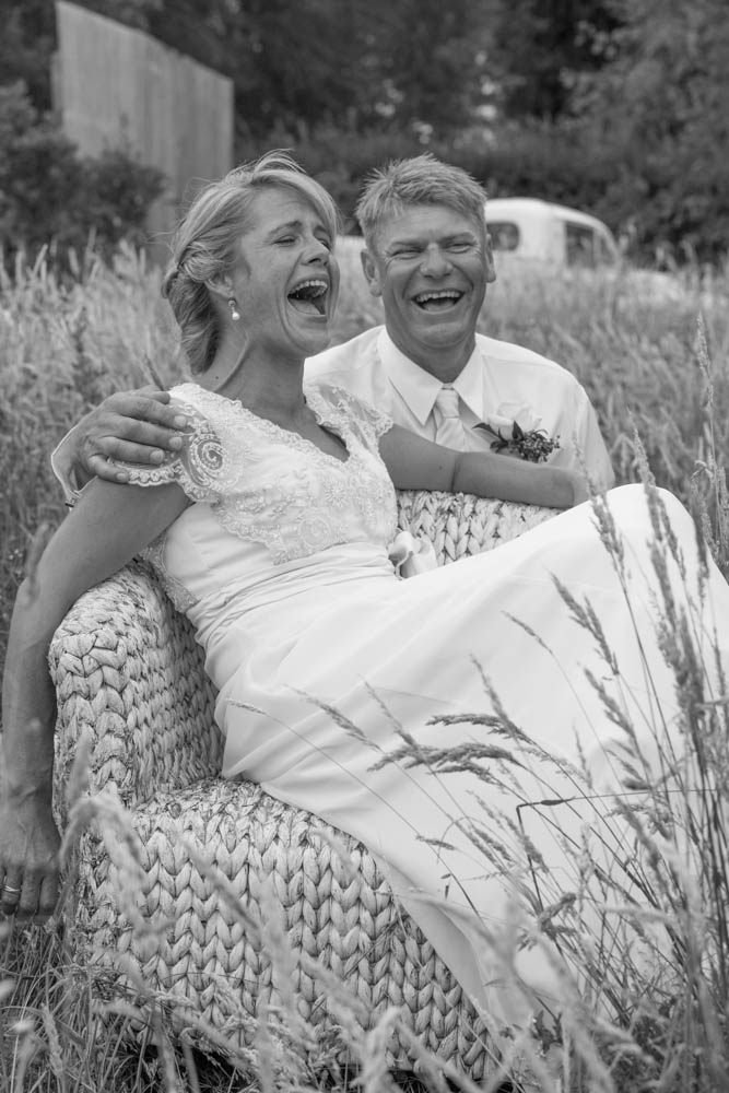 black and white image of a bride and groom laughing at Eagle Ridge Estate