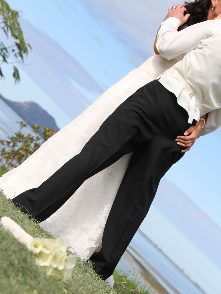 bride with her hand on the grooms bottom