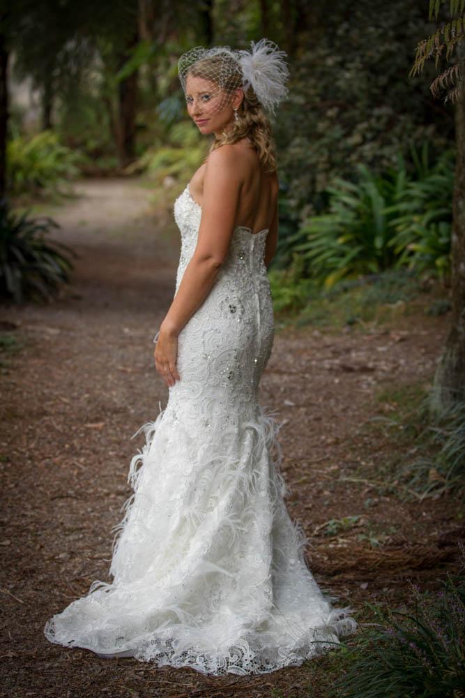 bride looking back over her shoulder at TePuna Quarry
