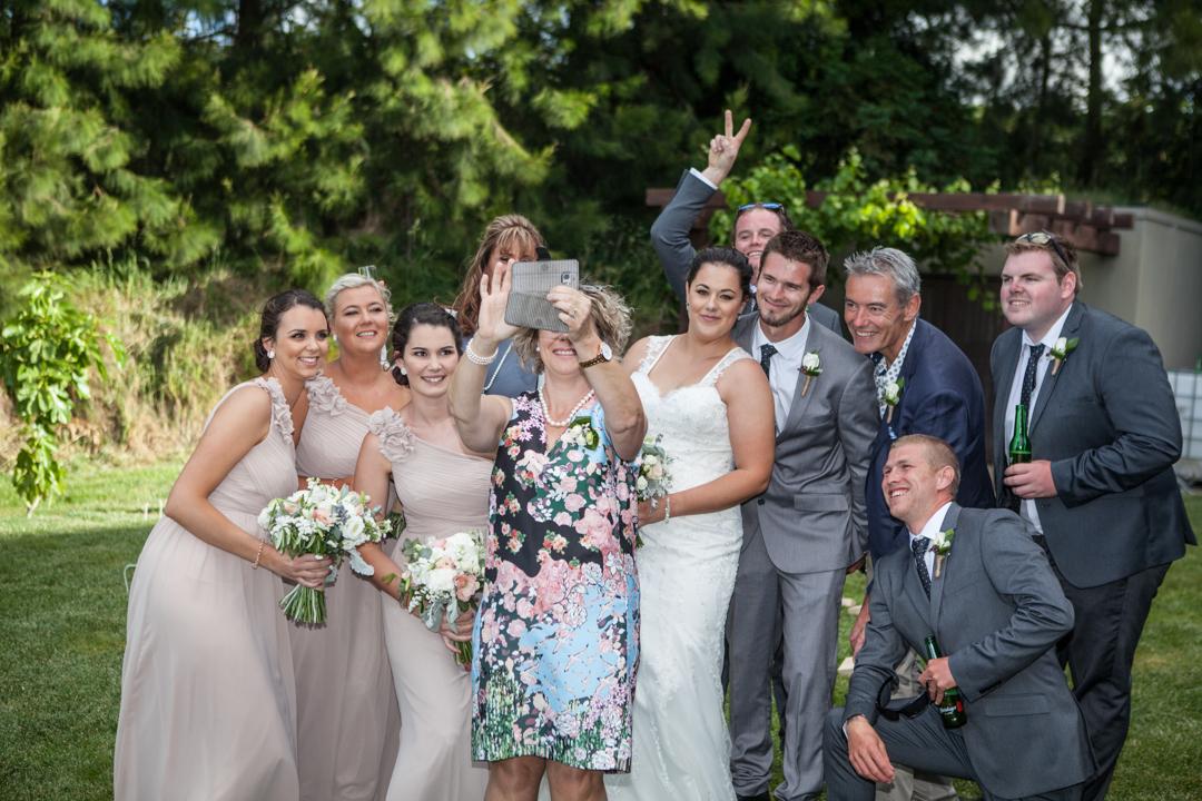 bridal party and brides parents selfie