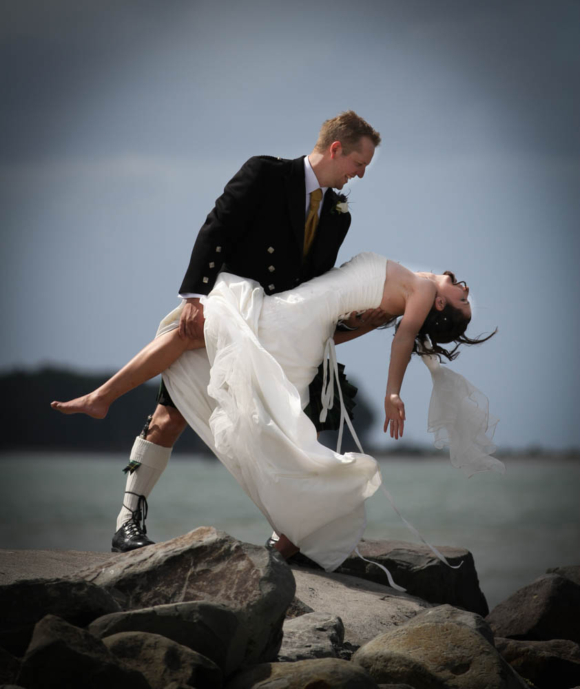 a Scottish groom dancing with his bride at Sulpher Point Tauranga