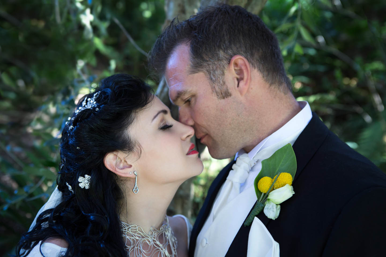 bride and groom having a romantic kiss at Eagle Ridge Estate