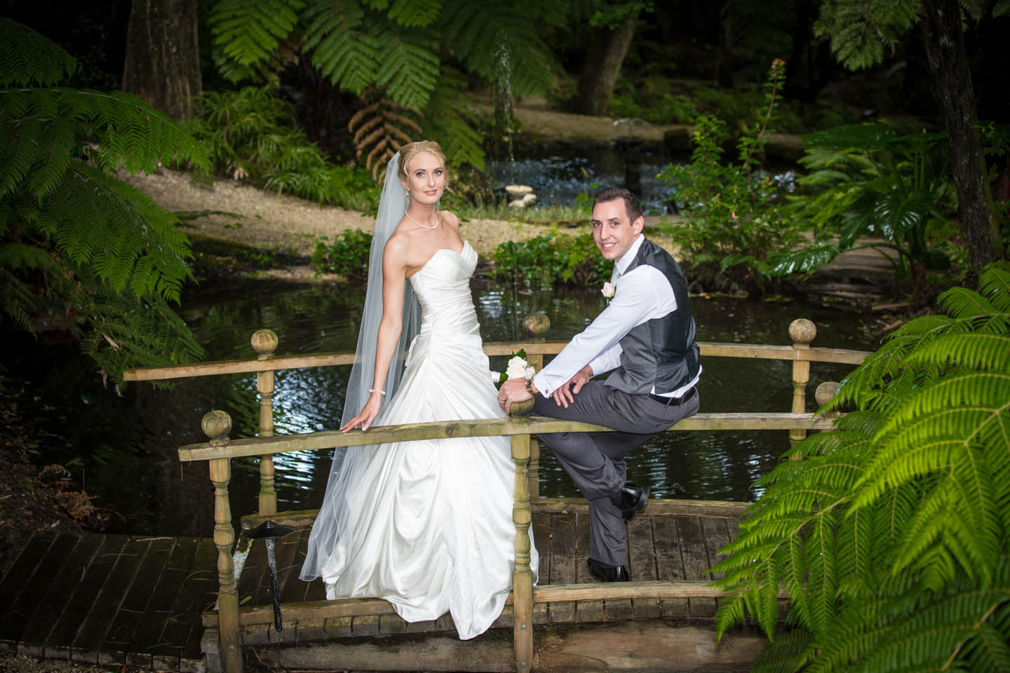 bride and groom on the bridge at Fountain Gardens in Tauranga