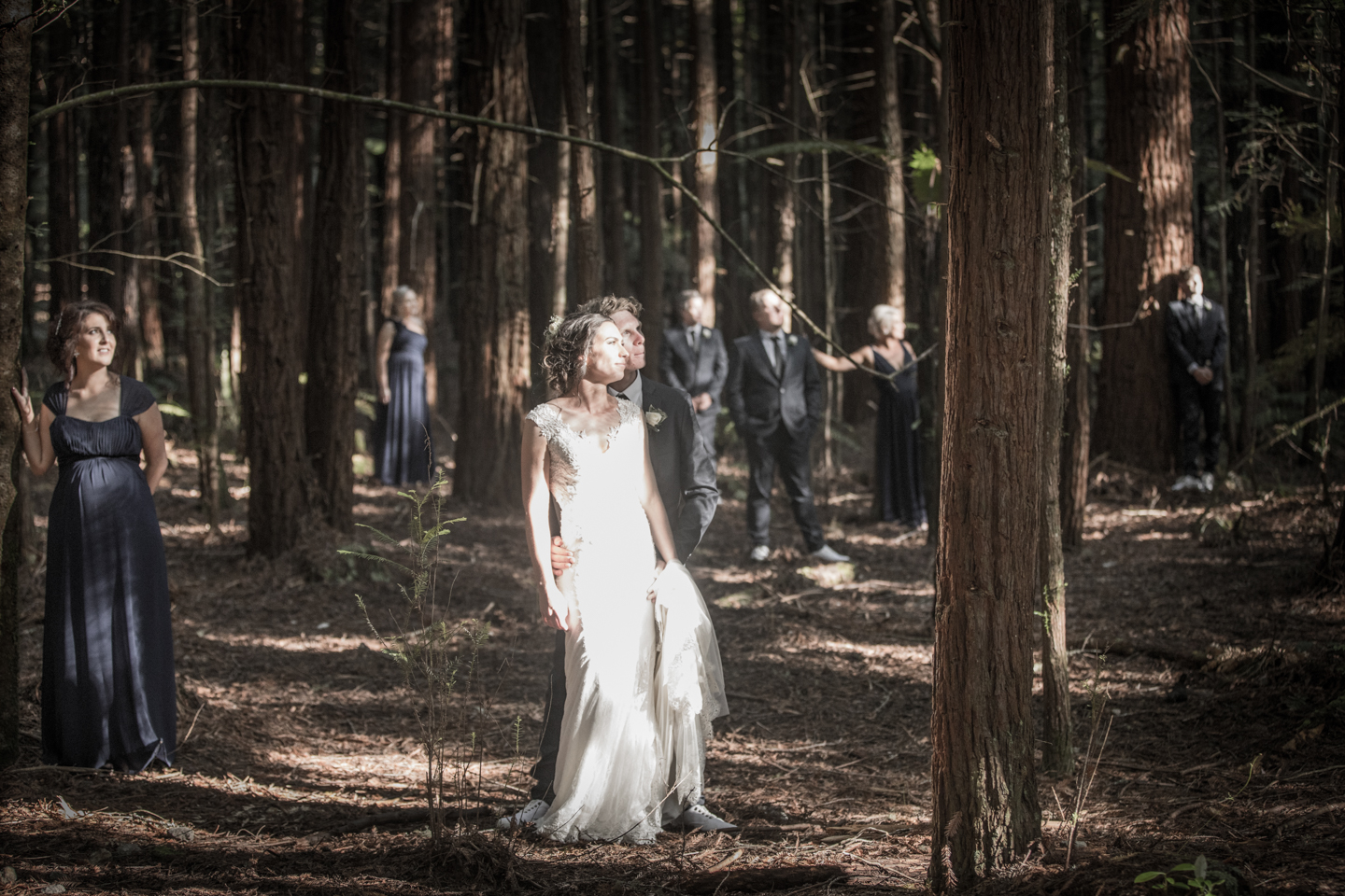 bridal party with all their faces in sunlight