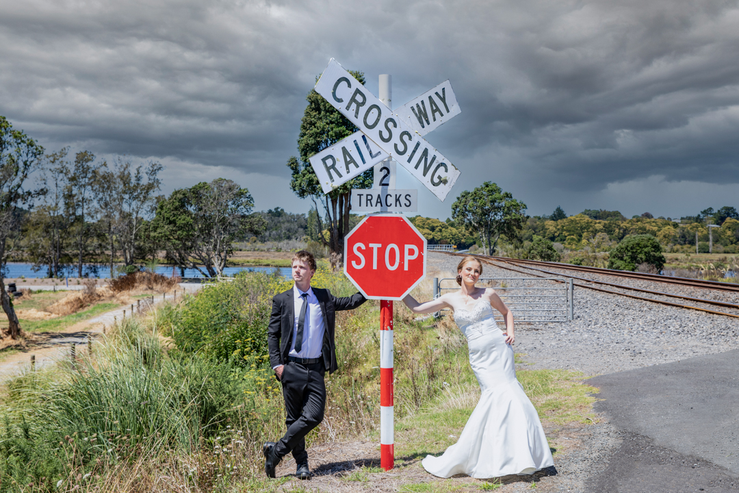 Bride and Groom by stop sign