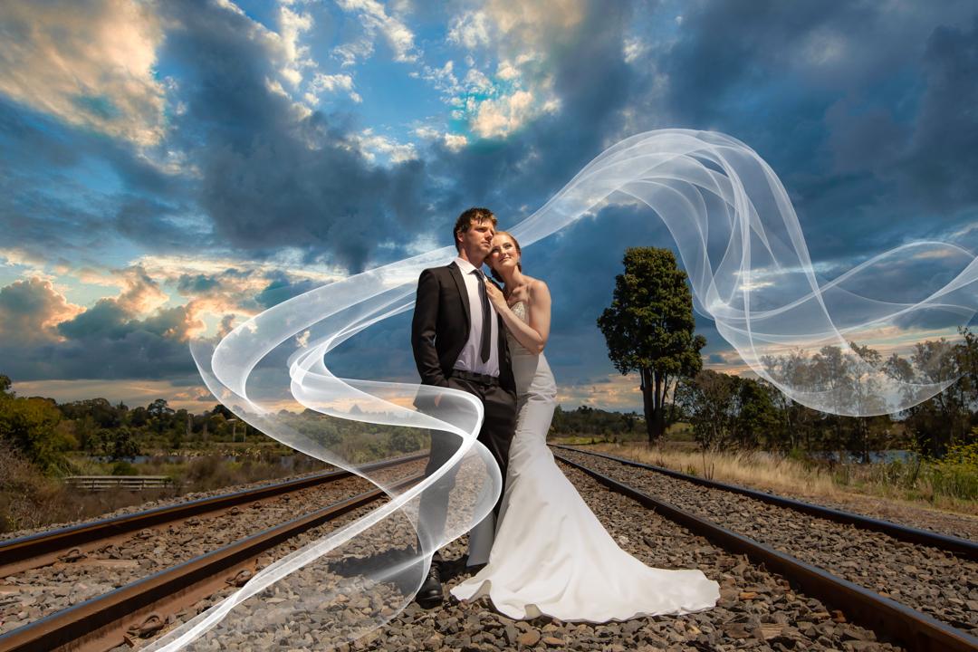 Bride and Groom on railway tracks