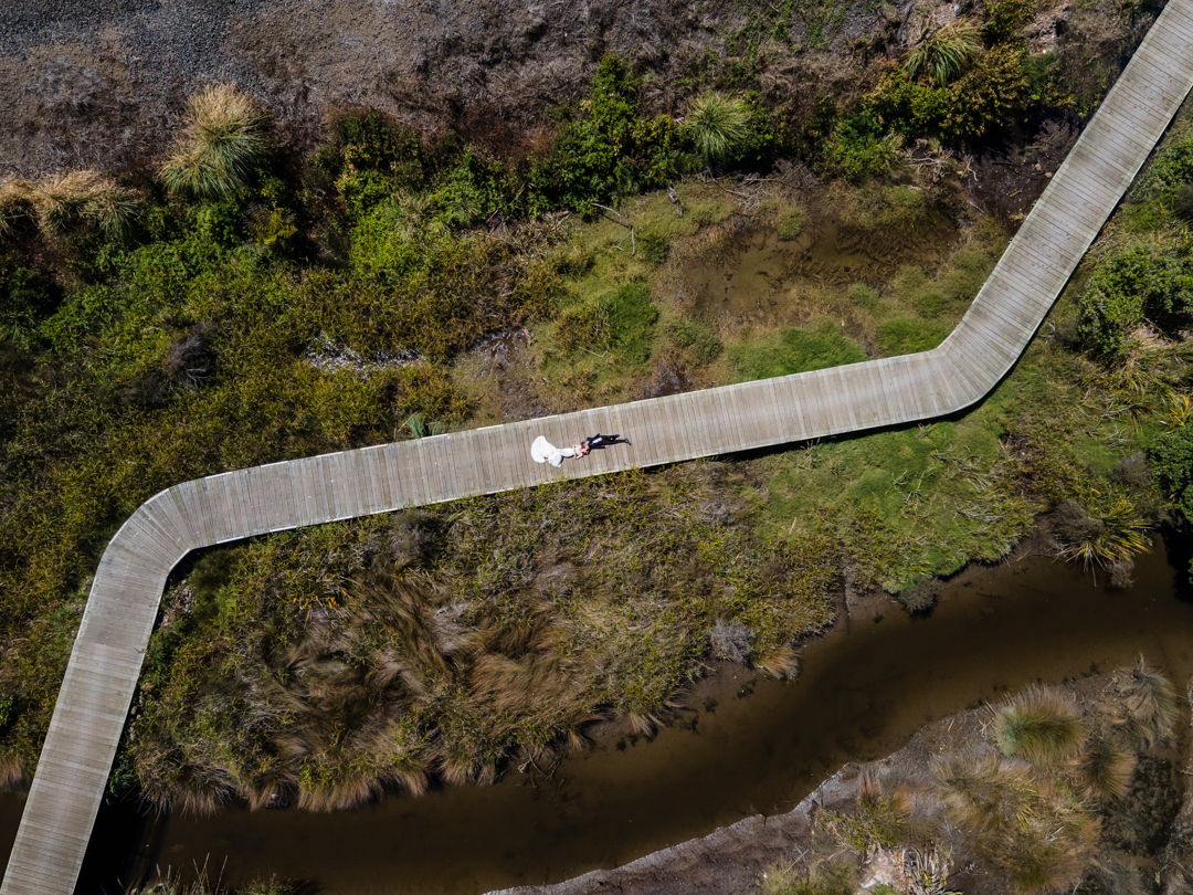 Bride and Groom on walkway with a drone
