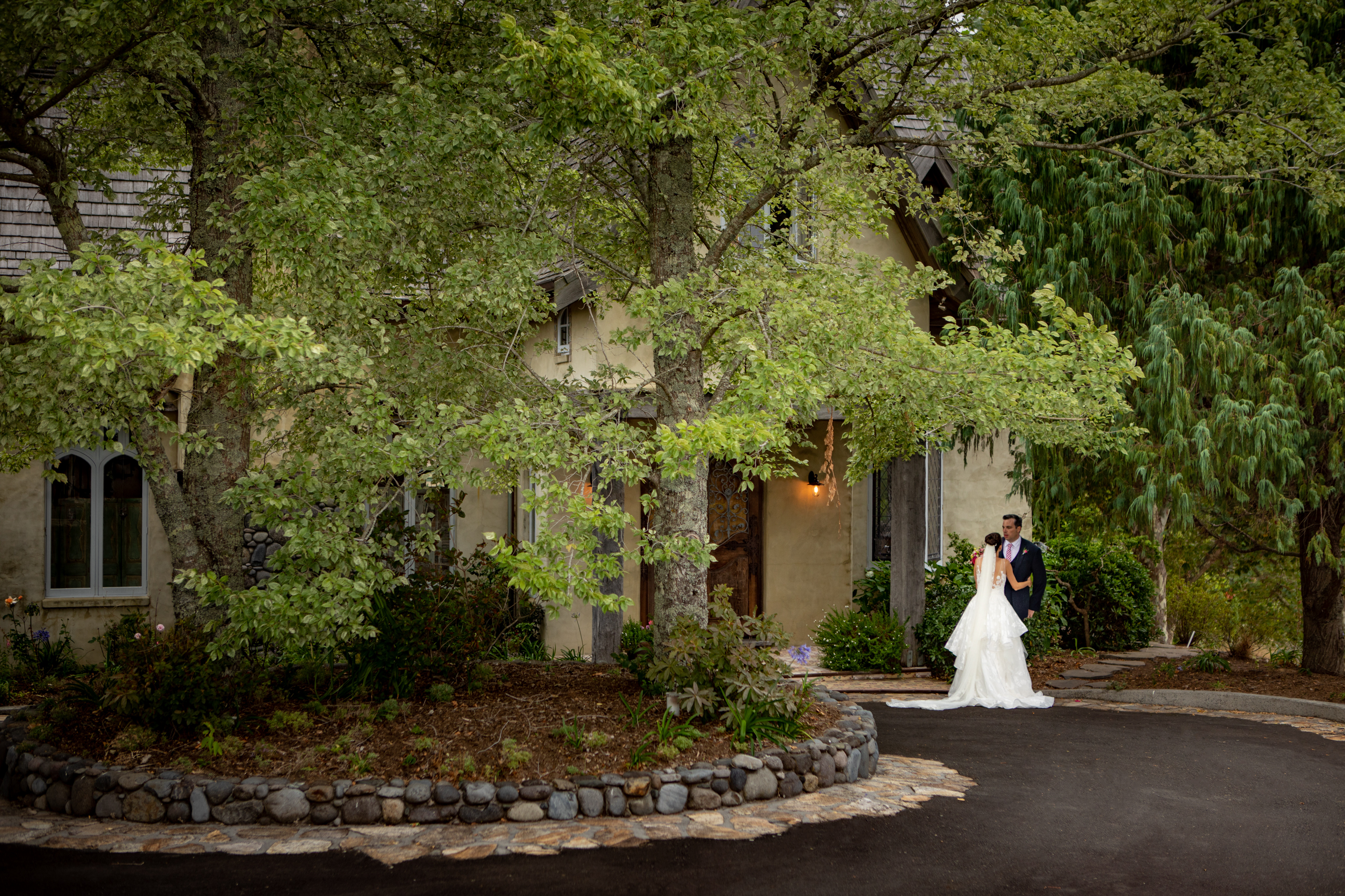 Bride and Groom out front French Country House Tauranga