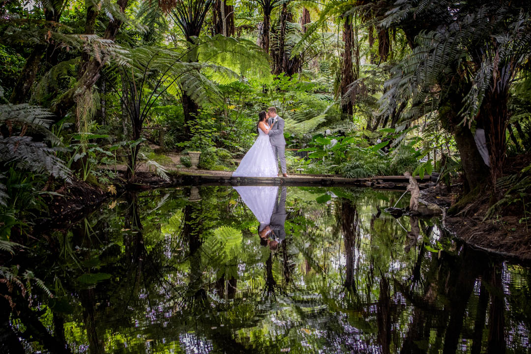 Bride and Groom reflection at Fountain Gardens