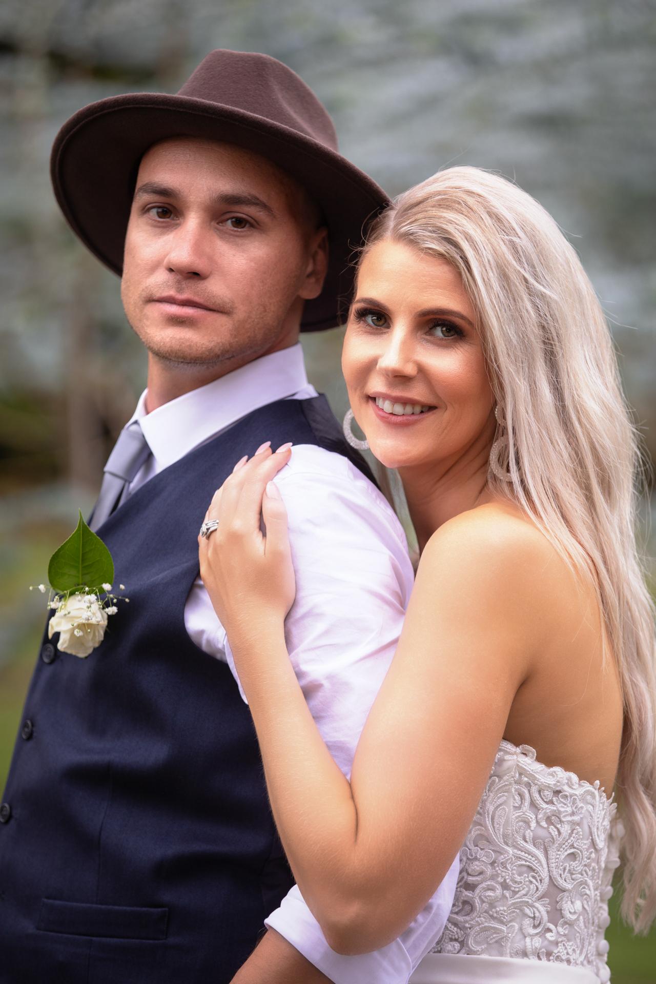 Bride cuddles groom Black Walnut Venue Omokoroa