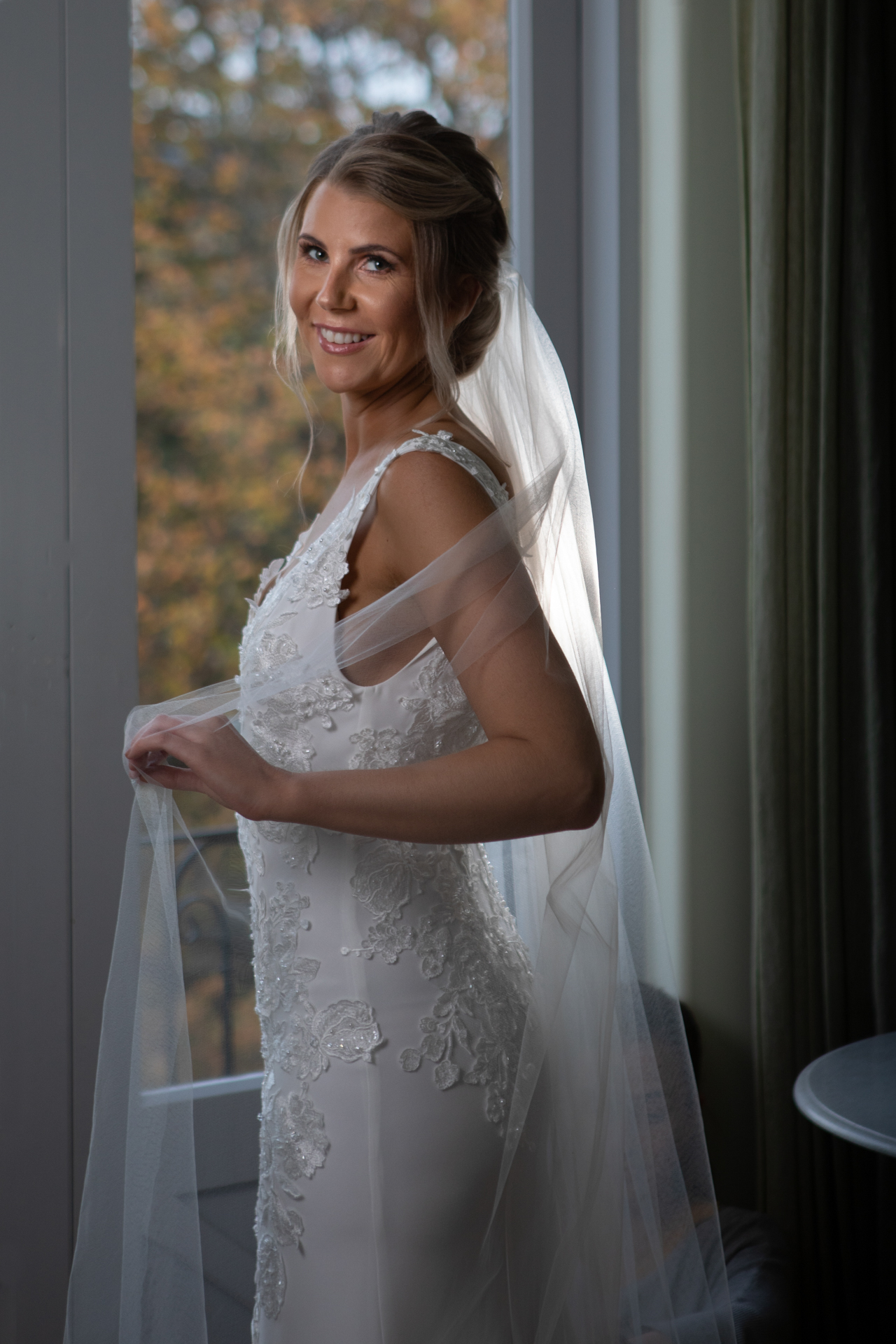Bride in window light French Country House