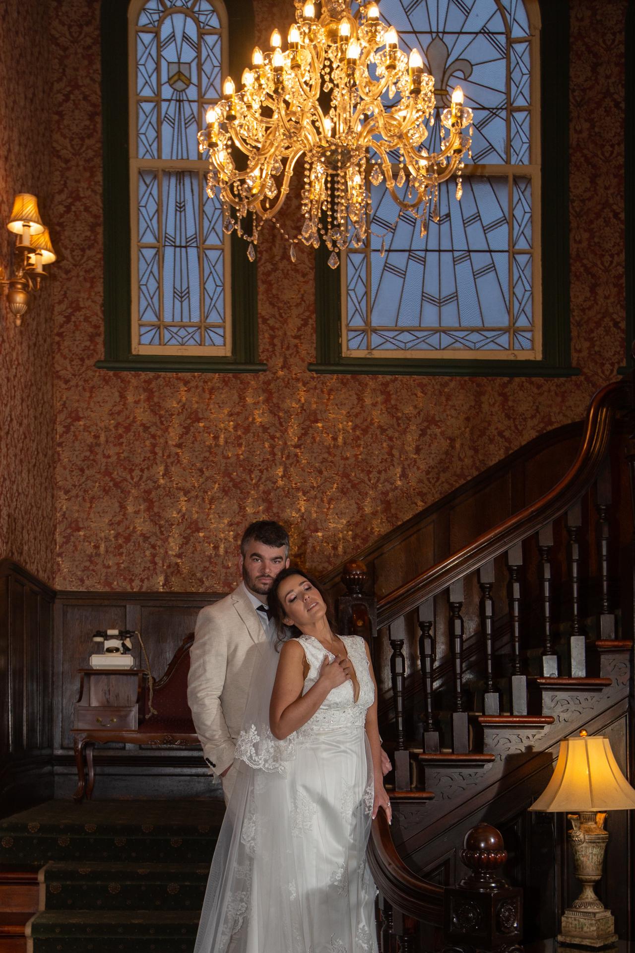 Bride nestles into to her hsbands neck Princes Gate Hotel Rotorua